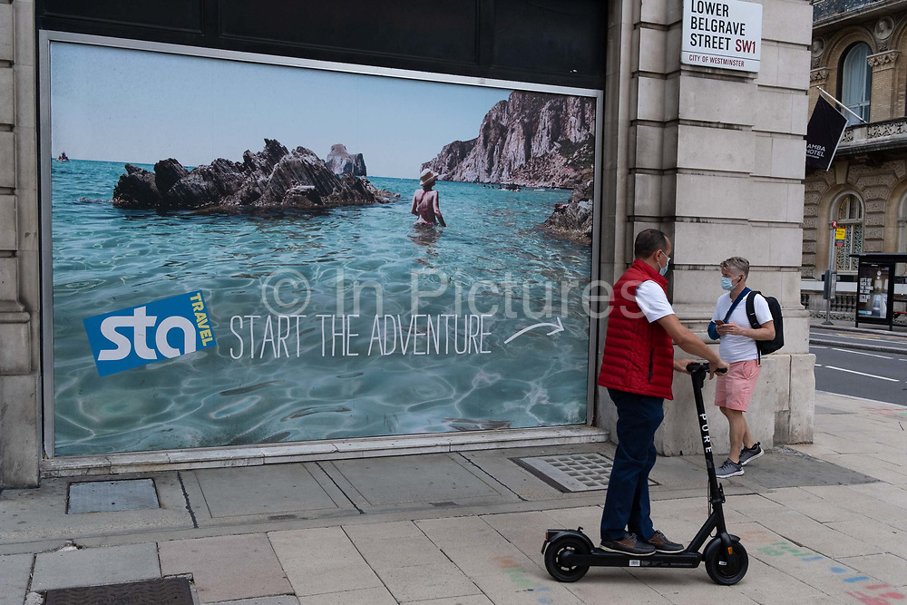 A poster showing a utopian beach is seen outside the Victoria offices of international budget flight and holiday booking service, STA Travel whose parent company has just announced its insolvency, a casualty of the Coronavirus pandemic, on 24th August 2020, in London, England. STA Travel Student Travel Australia was a travel agency specializing in youth travel. It was owned by the Swiss Diethelm Keller Holding DKH and employed almost 2,000 employees in over 200 stores worldwide. STA dated back to 1979 when two students in Australia organized the company after returning from their travels.