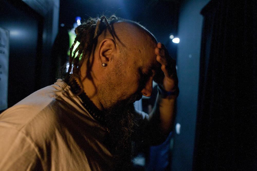 "Srdjan ""Gino"" Jevdjevic readies himself moments before he takes the stage as lead singer of Kultur Shock. .."