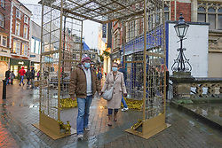 © Licensed to London News Pictures. 23/12/2019. Lincoln , UK. Shoppers wearing face coverings walk in Lincoln city centre. The county of Lincolnshire is expected to move into Tier 4 following a spike in coronavirus cases.  Photo credit: Ioannis Alexopoulos/LNP