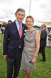 ARNAUD and CARLA BAMBERGER his is MD of Cartier UK at the 25th annual Cartier International Polo held at Guards Polo Club, Great Windsor Park, Berkshire on 26th July 2009.