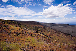 View from the Hilina Pali Overlook located on the crest of the HilinaPali. The 1,000 foot high escarpment is located in Hawaii Volcanoes National Park on the Big Island of Hawaii.