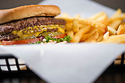 A cheeseburger in a basket with french fries at Feltner Brothers Burgers in Fayetteville, Arkansas.