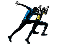 two men racing running sprinting in silhouette studio isolated on white background