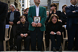 Relatives mourn as the remains of ten Lebanese soldiers are returned and laid to rest, Beirut, Lebanon, March 18, 2006. The soldiers received military honors after being identified through DNA testing. Families of the missing soldiers fought for information about their fate since they went missing during a battle with the Syrians over 15 years ago. The families were clinging to hope that the soldiers may have been transferred to Syrian prisons after battle. All of the soldiers were Christian.