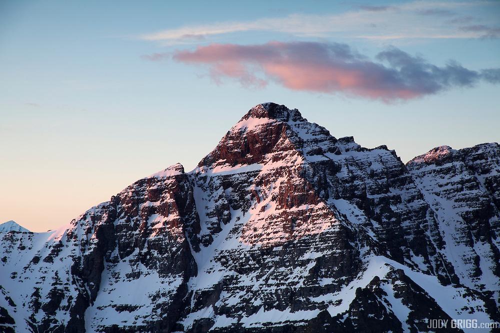 Sunrise strikes Pyramid Peak, Elk Mountains, Colorado.