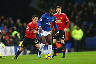 Yannick Bolasie of Everton shields the ball from Ander Herrera of Manchester United. Premier league match, Everton v Manchester Utd at Goodison Park in Liverpool, Merseyside on New Years Day, Monday 1st January 2018.<br /> pic by Chris Stading, Andrew Orchard sports photography.