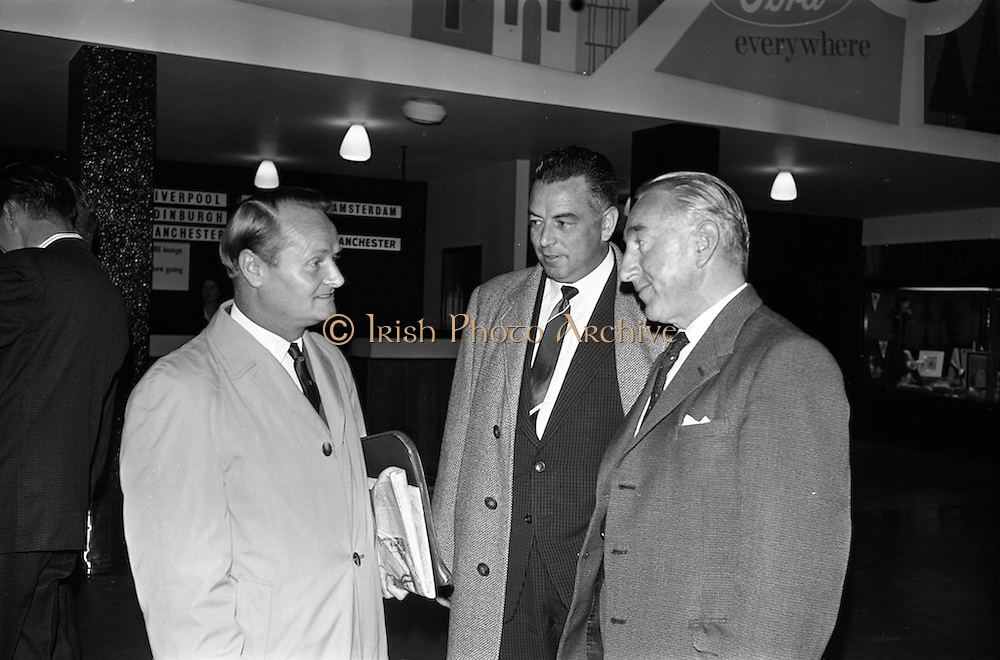 19/09/1963<br /> 09/19/1963<br /> 19 September 1963<br /> Massey Ferguson group departing Dublin for Paris Factory visit. A party of 23 executives of Massey Ferguson (Eire) Ltd. and dealers went on a three day visit to the Massey Ferguson factory at Beauvais, Paris as guests of Massey Ferguson France. Picture shows  Mr. M. Henderson, Director and General Manager, Massey Ferguson (Eire) Ltd. (left) chatting with Mr. R. Barry, General Manager O'K Garage Dunmanway, Co. Cork and (right) Mr. J. O'Keeffe, Managing Director, O'K Garage, Cork.