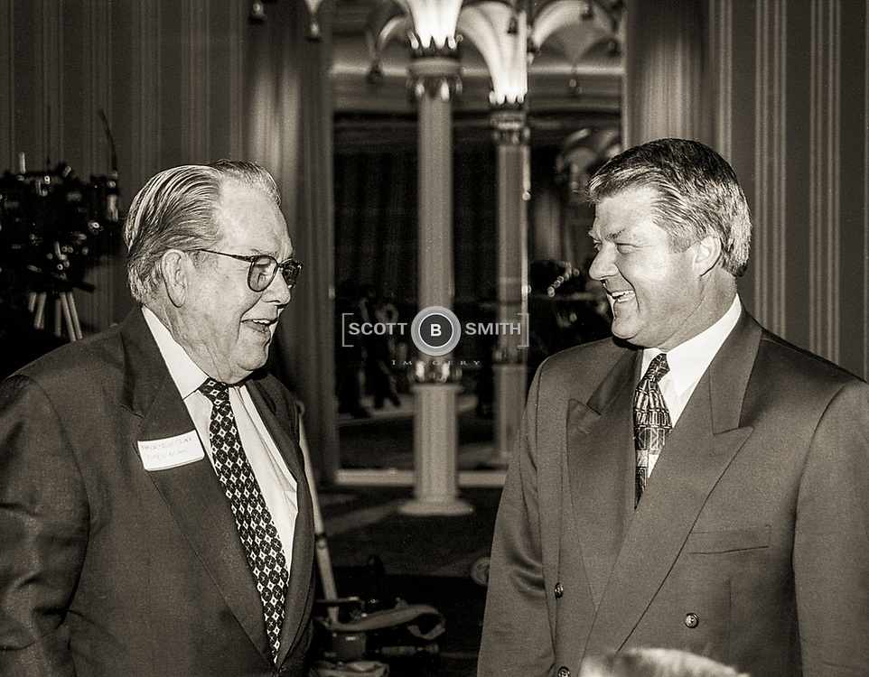 City of Miami Mayor Steve Clark and Coach Jimmy Johnson share a laugh at the media announcement of a new sports themed restaurant called Three Rings Bar and Grill on the ocean in the Eden Roc Resort, Miami Beach, November 1994.