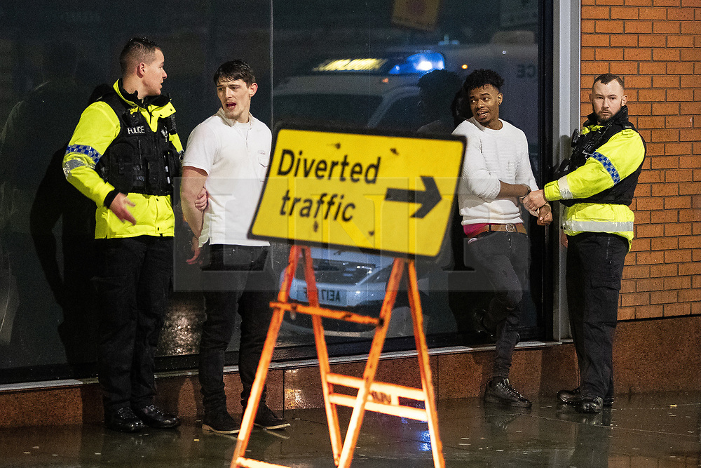 """© Licensed to London News Pictures . 22/12/2018 . Manchester , UK . Police detain two men after a fight breaks out outside The Birdcage nightclub on Withy Grove . Revellers out in Manchester City Centre overnight during """" Mad Friday """" , named for historically being one of the busiest nights of the year for the emergency services in the UK . Photo credit : Joel Goodman/LNP"""