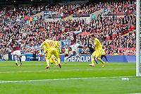 Aston Villa's Christian Benteke scores his sides equalising goal to make the score 1-1<br /> <br /> Photographer Craig Mercer/CameraSport<br /> <br /> Football - The FA Cup Semi-Final - Aston Villa v Liverpool - Sunday 19th April 2015 - Wembley - London<br /> <br /> © CameraSport - 43 Linden Ave. Countesthorpe. Leicester. England. LE8 5PG - Tel: +44 (0) 116 277 4147 - admin@camerasport.com - www.camerasport.com