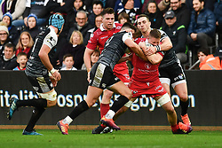 James Davies of Scarlets is tackled by George North of Ospreys<br /> <br /> Photographer Craig Thomas/Replay Images<br /> <br /> Guinness PRO14 Round 11 - Ospreys v Scarlets - Saturday 22nd December 2018 - Liberty Stadium - Swansea<br /> <br /> World Copyright © Replay Images . All rights reserved. info@replayimages.co.uk - http://replayimages.co.uk