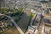 Nederland, Limburg, Gemeente Maastricht, 27-05-2013; <br /> Overzicht over de historische binnenstad met de rode toren van de Sint Janskerk op het Vrijhof en bruggen over de rivier, beneden in beeld de verkeersbrug John F. Kennedybrug (N278) over de rivier de Maas, de Hoge Brug, de Sint Servaasbrug, de Wilhelminabrug.  Op de rechteroever de nieuwe wijk Ceramique en het Bonnefantenmuseum.<br /> View on the old town of Maastricht on the left bank and the bridges  on the river Maar (Meuse).<br /> Bottom pic the John F. Kennedy Bridge (N278). On the right bank the new constructuted district Ceramique with the Bonnefantenmuseum.<br /> luchtfoto (toeslag op standaardtarieven);<br /> aerial photo (additional fee required);<br /> copyright foto/photo Siebe Swart.
