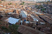 Nearly a million people live in makeshift houses made of plastic, cardboard and corrugated iron sheets in the Kibera slum, Africa's largest slum settlement located in Nairobi, Kenya.