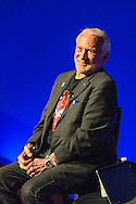 Garden City, New York, USA. October 23, 2015. Former NASA astronaut Edwin BUZZ ALDRIN has a conversation about his experiences in space and his new Children's  Middle Grade book Welcome to Mars: Making a Home on the Red Planet. After the talk at the jetBlue Sky Theater Planetarium at Long Island's Cradle of Aviation Museum, Aldrin signed copies of his new book. On the 1969 Apollo 11 mission, Buzz Aldrin was the second person ever to walk on the Moon, and his first trip to space was the 1966 Gemini 12.