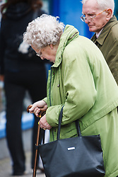 Old man and woman shopping for cane, Westport, County Mayo, Ireland