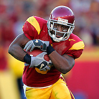 3 December 2005: #5 Reggie Bush runs with the football during Pac-10 College Football USC Trojans 66-19 win over their cross town rival UCLA Bruins during a day game at the Los Angeles Memorial Coliseum.  This was the last game for many senior players in Southern California. Reggie Bush is the winner of the 2005 Heisman Award by a landslide.