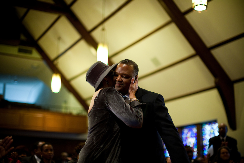 CHEVERLY, MD - DECEMBER 6: Prince George's County Executive-Elect Rushern Baker III receives a hug and kiss from his wife Christa Beverly Baker during an interfaith service at Cheverly United Methodist Church on his inauguration day on December 6, 2010 in Cheverly, Maryland. (Photo by Michael Starghill, Jr.)