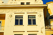Detail of building facade, with female faces in bas relief. Opatija, Croatia
