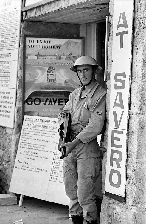Cyprus War 20 July–18 August 1974. Turkish invasion of Cyprus code-name by Turkey, Operation Attila. A Turkish soldier guards the harbour at the northern Cyprus town of Kyrenia shortly after the invasion August 1974. A Turkish flag flies on a nearby building. Photo by Terry Fincher.