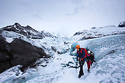 Tourists wearing protective clothing for glacier hike on Svinafellsjokull glacier an outlet glacier of Vatnajokull, South Iceland