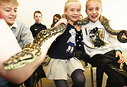 24/11/2019 repro free: Abaigh and Keelin McDonagh from Milltown  and Matilda the Carpet Python during the Bug Doctor's  talk  on the last day of the Galway Science and Technology Festival  at NUI Galway where over 20,000 people attended exhibition stands  from schools to Multinational Companies . Photo:Andrew Downes, xposure