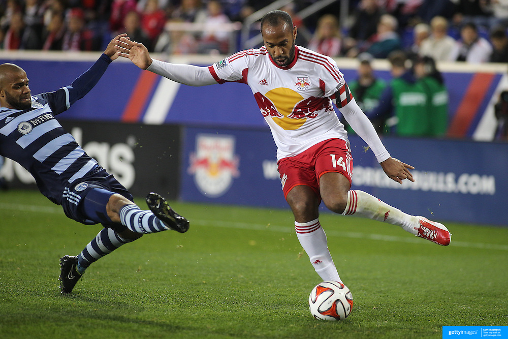 Thierry Henry, New York Red Bulls, evades the challenge  of Kevin Ellis, Sporting Kansas City, during the New York Red Bulls V Sporting Kansas City, Major League Soccer Play Off Match at Red Bull Arena, Harrison, New Jersey. USA. 30th October 2014. Photo Tim Clayton