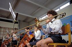 Schoolgirls playing in school orchestra at primary school UK