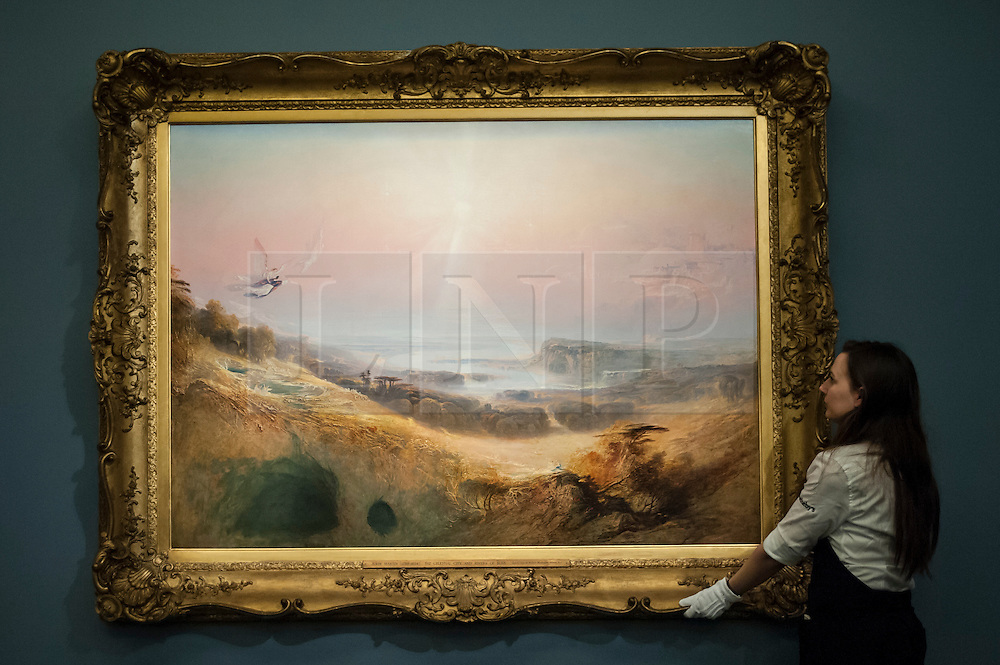 """© Licensed to London News Pictures. 06/07/2015. London, UK.  A Sotheby's technician shows John Martin's """"The Celestial City and the River of Bliss"""" (est. £2m to £3m) at the preview of Old Masters, British Paintings and Masterworks from the collection of Castle Howard at Sotheby's ahead of the auction on July 8. Photo credit : Stephen Chung/LNP"""