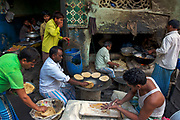 Chapati production goes into full swing at lunchtime, Jorasanko district,Calcutta, West Bengal