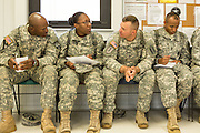 A women Drill Sergeant candidate sits among her male counterparts at the US Army Drill Instructors School Fort Jackson September 26, 2013 in Columbia, SC. While 14 percent of the Army is women soldiers there is a shortage of female Drill Sergeants.
