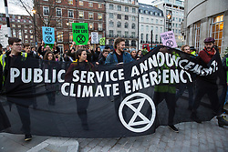 London, UK. 21st December, 2018. Environmental campaigners from Extinction Rebellion arrive to remember the 27 people found burnt alive in the Greek village of Mati after July's wildfires during a protest outside Broadcasting House against the lack of coverage by the BBC of the climate change crisis.