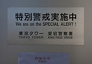 A sign at Tokyo Tower warning of increased security due to terrorism risks.. Tokyo, Japan. Friday February 3rd 2012