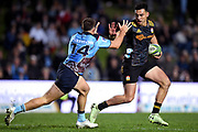 Shaun Stevenson of the Chiefs fends off Alex Newsome of the Waratahs during the Round 5 Trans-Tasman Super Rugby match between NSW Waratahs and Waikato Chiefs at Brookvale Oval in Sydney, Saturday, June 12, 2021. (AAP Image/Dan Himbrechts) NO ARCHIVING, EDITORIAL USE ONLY