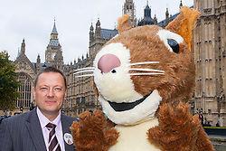 "Nature campaigners accompanied by a  giant red squirrel, Bob, urge MPs to ""Vote For Bob"" during a photocall outside Parliament. Their aim is to get MPs to support nature in Britain. Pictured: Jason McCartney MP poses with Bob the red squirrel."