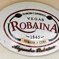 Cnetral America, Cuba, Pinar del Rio, San Luis. Vegas Robaina Cuban Cigar sign at Finca Robaina plantation.