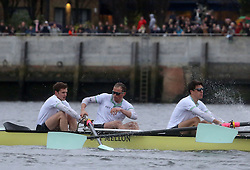 © Licenced to London News Pictures. 06/04/2014. London. UK.  <br /> Cambridge University's Luke Jukett is pictured as he 'caches a crab' during the annual BNY Mellon Boat Race between the two crews on the River Thames in London, April 6th, 2014. <br /> Credit: Susannah Ireland