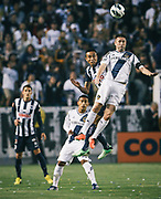 Los Angeles Galaxy forward Robbie Keane, right, wins the ball from Monterrey forward Jesus Eduardo Zavala during the first half of the CONCACAF Champions League semifinal, Wednesday, April 3, 2013, in Carson, Calif. (AP Photo/Bret Hartman)
