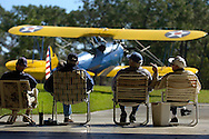 Airshow attendees are framed with a 1941 Boeing Stearman biplane in Belleview, FL, March 09, 2008.