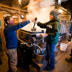 Keith Fifield and his niece Megan Perkins tend the sap evaporator at the Fifield's Sugarhouse in Strafford, Vermont.