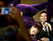 David Chin has his photo taken with contortionist Caroline Hager at the Hotel ZaZa 10th anniversary party on Saturday, January 19, 2013 in Dallas, Tx. (Cooper Neill/The Dallas Morning News)