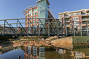 River Place bridge Paradigm Pathway at Art Crossing over the Reedy River in downtown Greenville, South Carolina.