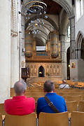 Two men sit on a pew in Rochester cathedral, on 22nd July, in Rochester, England