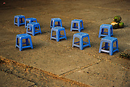 Empty blue plastic stools of a street coffee shop in Truc Bach lake, Hanoi, Vietnam, Asia