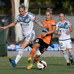 BRISBANE, AUSTRALIA - JANUARY 1: Katrina Gorry of the Roar dribbles the ball in front of Laura Spiranovic of the Victory during the round 10 Westfield W-League match between the Brisbane Roar and Melbourne Victory at AJ Kelly Park on January 1, 2017 in Brisbane, Australia. (Photo by Patrick Kearney/Brisbane Roar)
