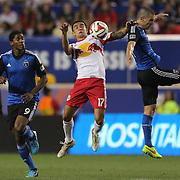 Tim Cahill, (centre), New York ed Bulls, challenges for the ball during the New York Red Bulls Vs San Jose Earthquakes, Major League Soccer regular season match at Red Bull Arena, Harrison, New Jersey. USA. 19th July 2014. Photo Tim Clayton