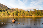 View of the opposite bank of the River Leven in the evening, just as it enters Loch Leven, just outside Kinlochleven, in the Scottish Highlands.