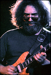 Jerry Garcia, concentrating, playing guitar. With the Grateful Dead in Concert at the Huntington Civic Center, Huntington West Virginia on 16 April 1978. Image No. 78C16-03