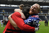 Football - 2018 / 2019 Sky Bet EFL League Two - MK Dons vs. Mansfield<br /> <br /> Milton Keynes Dons' Robbie Simpson celebrates with Ousseynou Cisse promotion after their 1-0 victory, at Stadium MK.<br /> <br /> COLORSPORT/ASHLEY WESTERN