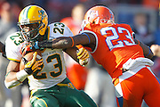 North Dakota State Bison running back John Crockett (23) is tackled by Sam Houston State Bearkats defensive back Robert Shaw (23) during the FCS title game at FC Dallas Stadium in Frisco, Texas, on January 5, 2013.  (Stan Olszewski/The Dallas Morning News)
