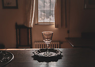 Wine glass on a silver platter in a house interior